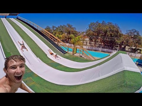 MEGA RAMP WATERSLIDE BELLY FLOP! *Girlfriend gets wind knock