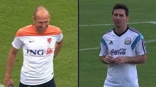 The Netherlands' Robben confronts Argentina's Messi