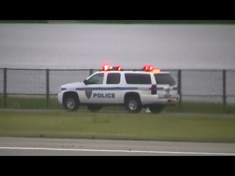 NYC JFK Airport Port Authority NY & NJ PD units driving w/ lights on in the distance [NY | 7/2013]