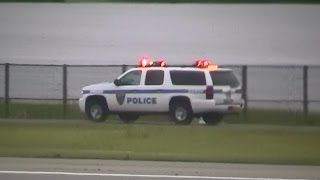 NYC JFK Airport Port Authority NY & NJ PD units driving w/ lights on in the distance [NY   7/2013]