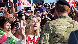 Prince Harry stuns fan holding 'marry me' sign with kiss on cheek