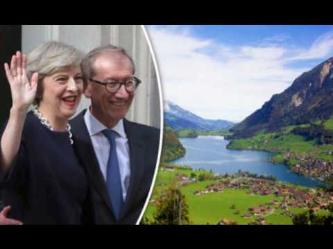 Swiss banksters give Theresa May her orders on Alpine 'walking holiday'