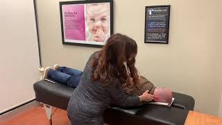 Dr. Megan adjusts Dr. Jared for Optimal Wellness - Royersford, PA Chiropractor