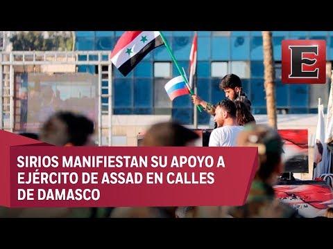 Sirios se manifiestan a favor de las fuerzas armadas de su país