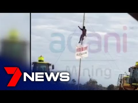 Two Protesters Arrested After Chaining Themselves At Adani Mine | 7NEWS
