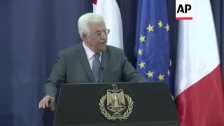 Abbas says Palestinians committed to 9 months of peace talks; Hollande urges compromise