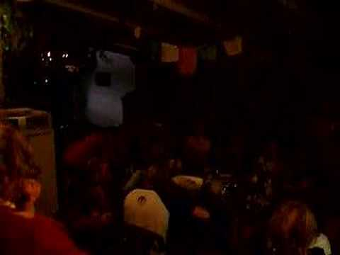 """Backpackers singing """"Help"""" by the Beatles in a Perth hostel"""