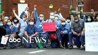 Frontline health care workers kneel in solidarity | WNT