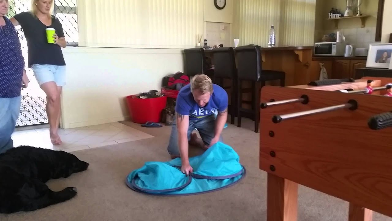 Folding a pop up beach tent & Folding a pop up beach tent - YouTube