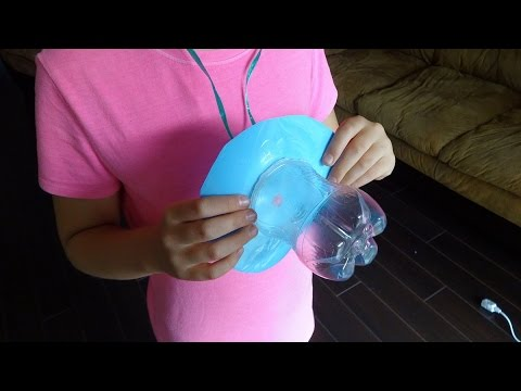 Recycled crafts ideas giant baby dummy from plastic soda for Plastic project ideas