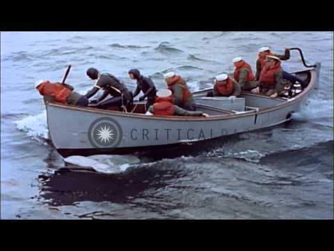 Training on use of a motor whale boat and rescue crew to rescue a downed US Navy ...HD Stock Footage