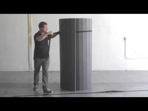 Applying Straps to Carpet Rolls