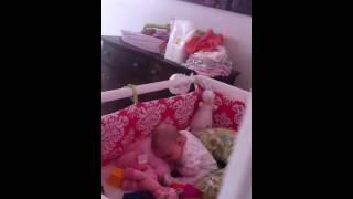 Aida falls asleep in crib