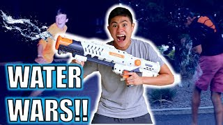 EPIC WATER GUN PRANK!! **WATER WARS**