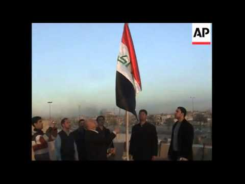 New Iraq flag stripped of Baath Party symbols is hoisted