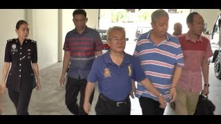 Two businessmen charged with illegal deposit taking