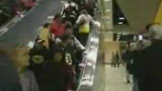 Girl Tries To Go Up A Down Escalator
