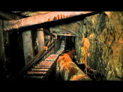 Flooded Abandoned Mine Tunnel With Waterfall Raise