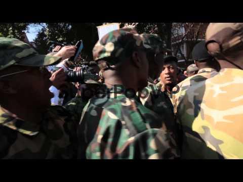 Close up of military veterans singing and dancing. Member...