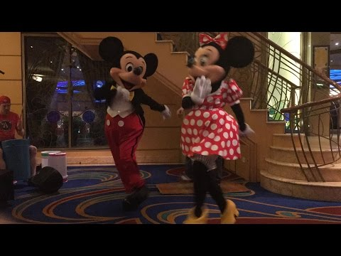 Mickey and Minnie dancing with Buckets n' Boards on the Disney Wonder