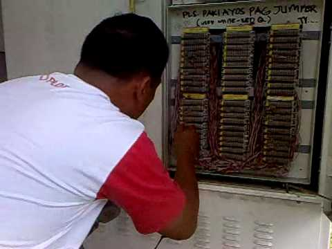 Telecom Technician repairing a reported telephone complain.mp4