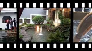 rumah bambu diatas kolam