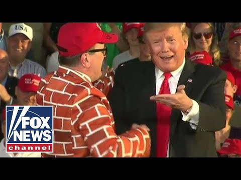 Watch: Trump fan in wall-styled suit shows up to Trump rally