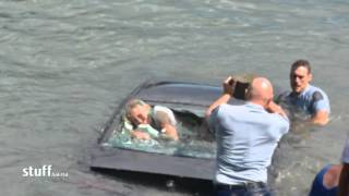 NZ woman rescued from sinking car     00:46