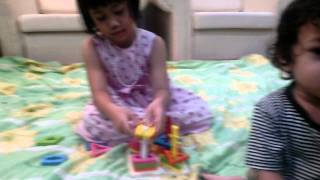 My Children Playing The Wooden Puzzle Educational Toy