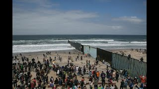 mexican migrants illegally crossing the tijuana border into the us