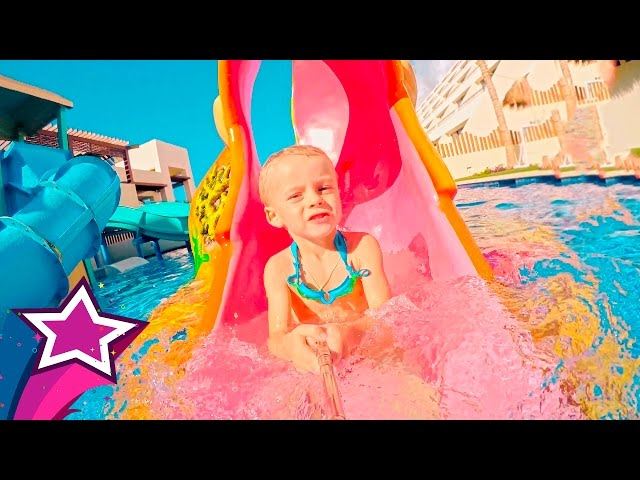 Max Plays Slides at Water Park Having a Blast on Water Slides in Cancun Kids Toys waterpark Day 2