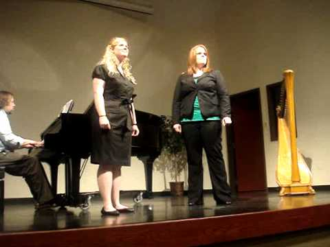 This is me singing at my school during a recital my freshman year in college (in 2008). My friend Liz (the red head) and I are singing the song For Good from the hit musical Wicked.