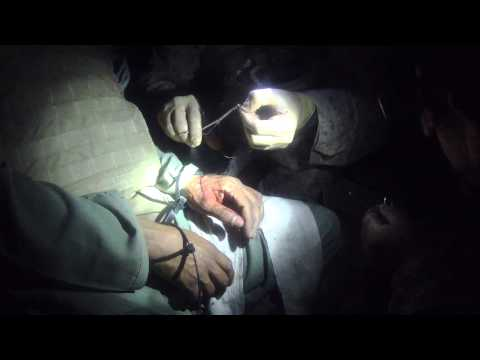 Navy FMF Corpsman sutures D-bag taliban hand in sangin Afghanistan