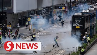 Police fire tear gas in Hong Kong protests condemning proposed security legislation