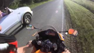 Motorcycle almost gets ran off the road. Driver gets headbutted REKTD