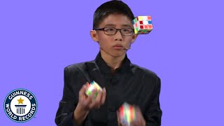 He JUGGLED and SOLVED 3 Rubik's cubes!  Guinness World Records