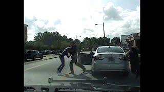 Dash Cam Shows Officer Punching Black Motorist