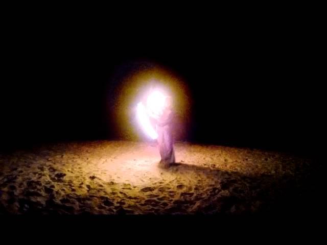 Fire By Design - poi on the beach Cedar Key Pirate Invasion 2015