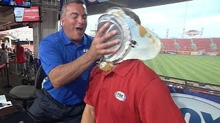 Reds broadcaster loses bet, gets pied