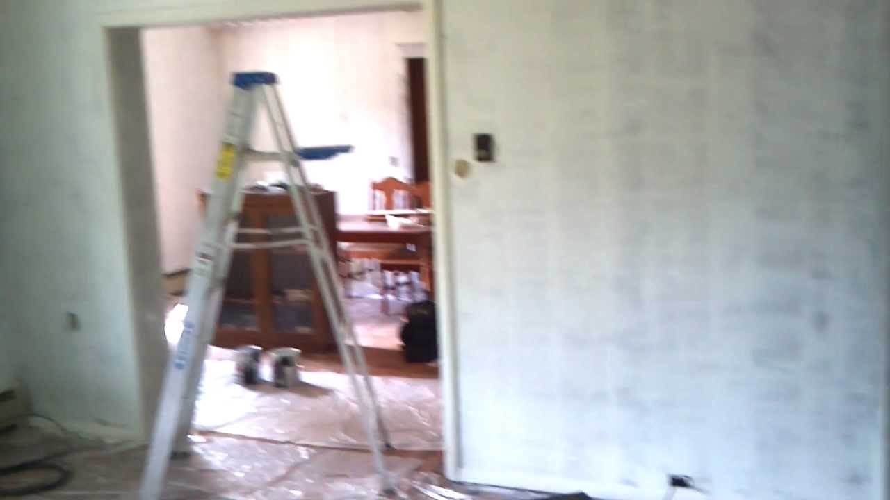 Diy covering up fake wood paneling way better looking How to disguise wood paneling