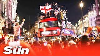 England fans jump on buses & set off fireworks celebrating Euro 2020 win as riot cops held crowds