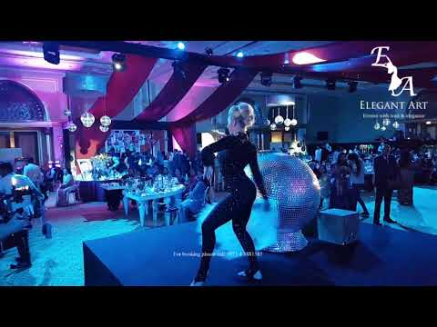 Mirror globe contortionist in Dubai by Elegant Art Events, UAE