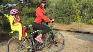 как выбрать детское кресло для велосипеда? Велокресла Bellelli