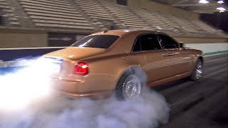 Arab Rolls Royce Ghost destroying tyres on the drag strip!