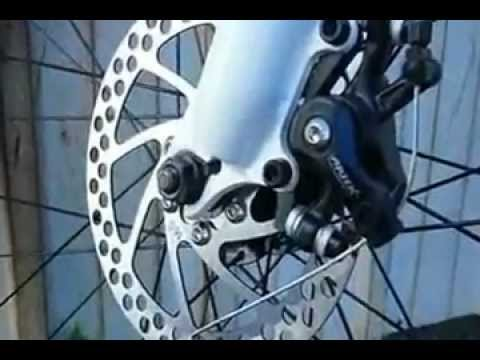 Genesis V2100 Mountain Bike Closeup Rotor And Front Disk Brake