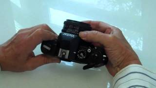 how to load and unload film in a 35 mm camera