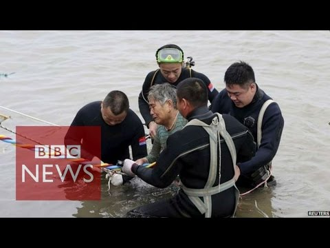 China ship carrying 450 capsizes: Video shows rescue of woman - BBC News