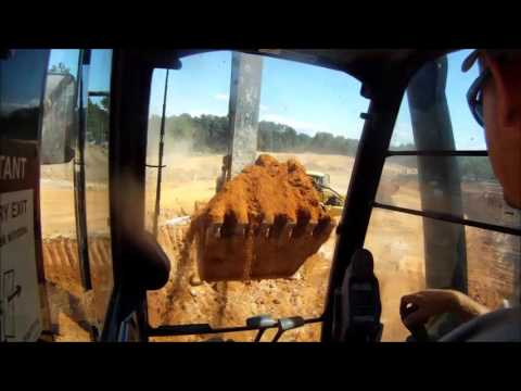 Deere 350G Excavator Loading Trucks