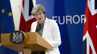 Theresa May says she is confident UK can achieve positive Brexit deal