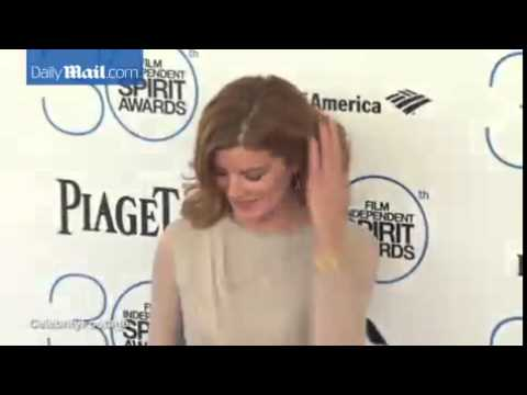 Rene Russo stuns in sheer nude dress at...